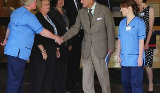 Britain's Prince Philip thanks hospital staff as he leaves the Aberdeen Royal Infirmary in Aberdeen, Scotland, on Monday, Aug. 20, 2012, after treatment for a bladder infection. (AP Photo/Andrew Milligan, PA Wire)