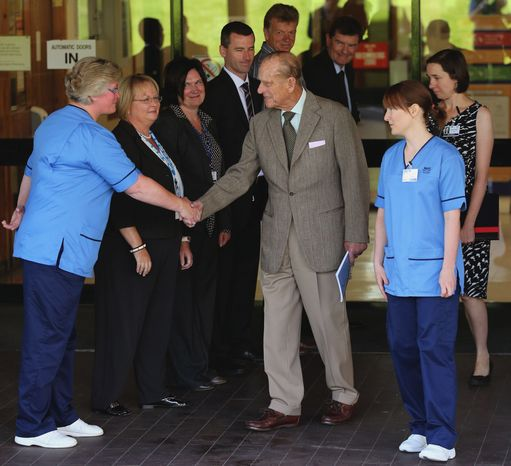 Britain's Prince Philip thanks hospital staff as he leaves the Aberdeen Royal Infirmary in Aberdeen, Scotland, on Monday, Aug. 20, 2012, after treatment for a bladder infection. (AP Photo/Andrew Milli