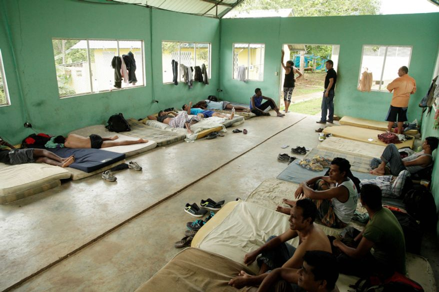 Migrants rest in a shelter after being found in the Darien province by Panama border police in Meteti, Panama. Panamanian authorities began noticing five years ago that the Darien Gap, the only interruption in the Pan-American Highway, was being used by migrant smugglers, usually to move people from Asia and Africa.  (AP Photo/Arnulfo Franco)