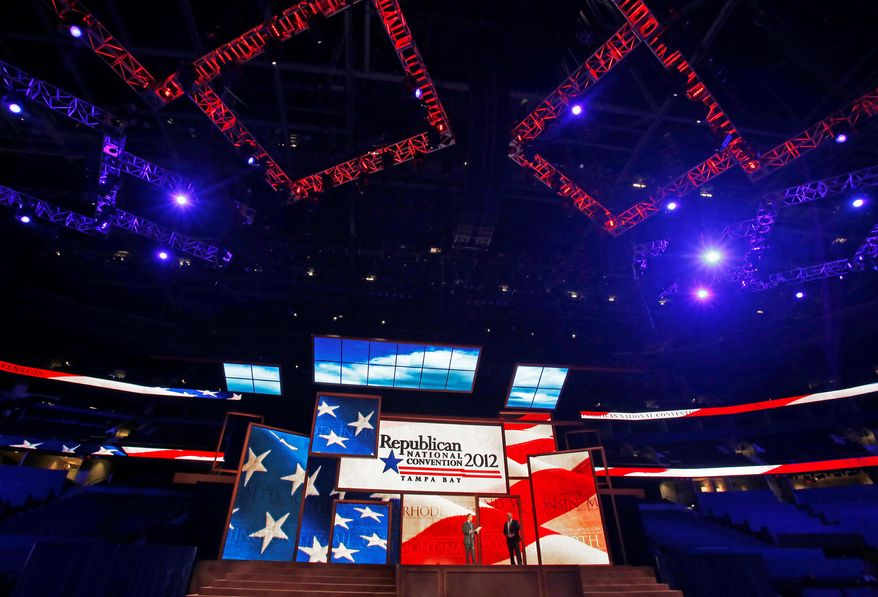 Republican National Committee Chairman Reince Priebus (left) and convention CEO William Harris on Monday unveil the stage for the 2012 Republican National Convention in Tampa, Fla. The 40-by-60 foot stage cost a reported $2.5 million. (Associated Press)