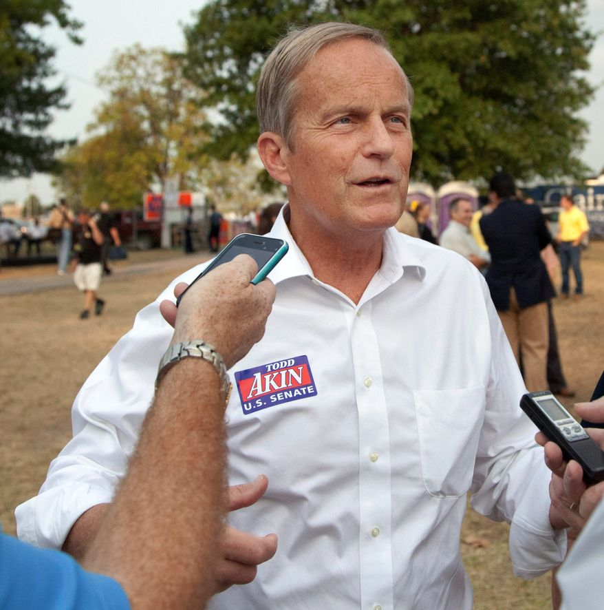 Rep. W. Todd Akin, Missouri Republican, is under heavy pressure from his own political party to quit the race for the U.S. Senate after insensitive remarks he made regarding rape and abortion. (Associated Press)