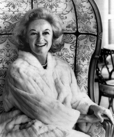 Phyllis Diller, dressed up for a portrait in 1969, more often appeared with a bizarre hairdo, ensemble and makeup; a cackle and stories poking fun at herself and a husband she called Fang. Female comics were rare when she hit it big in the 1950s. (Associated Press)