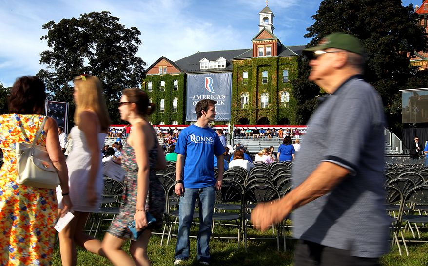 Supporters file in to hear Republican presidential candidate Mitt Romney and his running mate, Rep. Paul Ryan, speak at a town-hall event on Monday, Aug. 20, 2012, at St. Anselm College in Manchester, N.H. (AP Photo/Cheryl Senter)