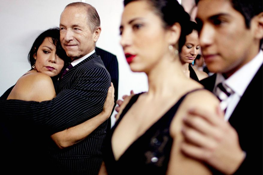 Italy's dancers Eloina Martins, left, and Paolo Nelzi, second from left, among others, wait before competing during the 2012 Tango Dance World Cup in Buenos Aires, Argentina, Monday, Aug. 20, 2012. The two-week long event offers more than 500 free dance lessons, concerts and recitals. Hundreds of professional dancers compete in the championship and teach many the eight basic steps of the dance in the city where it was born. (AP Photo/Natacha Pisarenko)