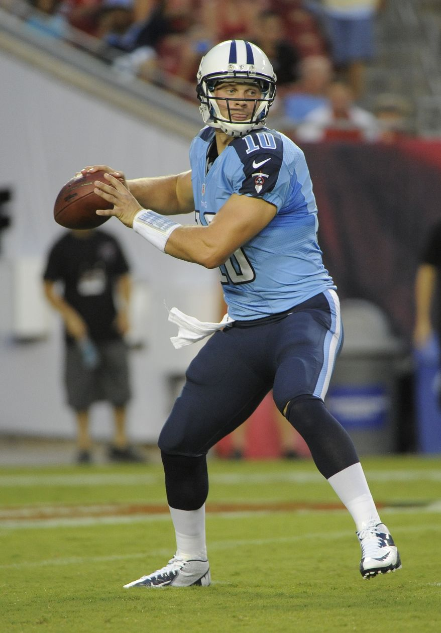 Tennessee Titans QB Jake Locker drops back to pass Aug. 17, 2012, during an NFL preseason football game against the Tampa Bay Buccaneers in Tampa, Fla. (Associated Press)