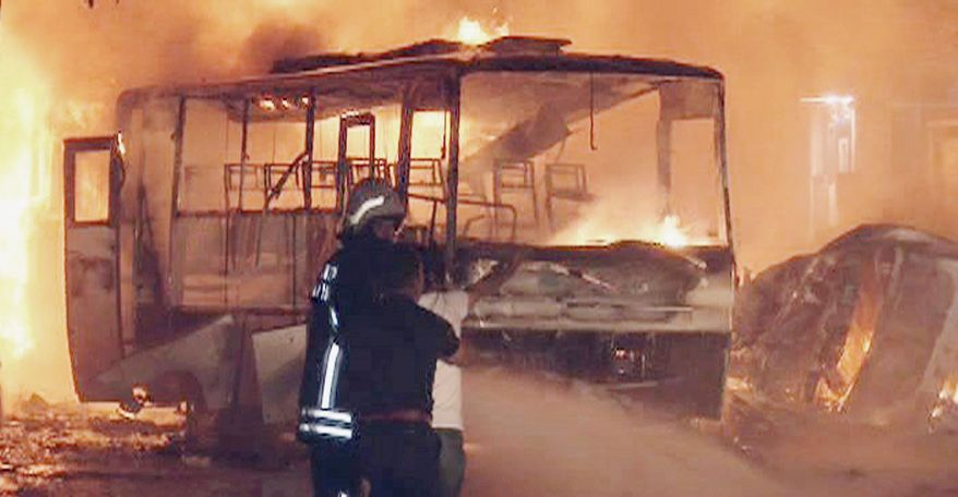 Firefighters battle the blaze as vehicles burn after a blast near a police station in Gaziantep, Turkey, on Monday. Nine people were killed and dozens were wounded amid an escalation in fighting between Kurdish rebels and Turkish security forces. (Associated Press)