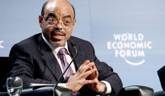 Ethiopian Prime Minister Meles Zenawi, seen here speaking at the 20th World Economic Forum on Africa in May 2010 in Dar es Salaam, Tanzania, died Monday, after weeks of illness, Ethiopian state media reported. Mr. Meles, who took power in 1991, was 57. (Associated Press)