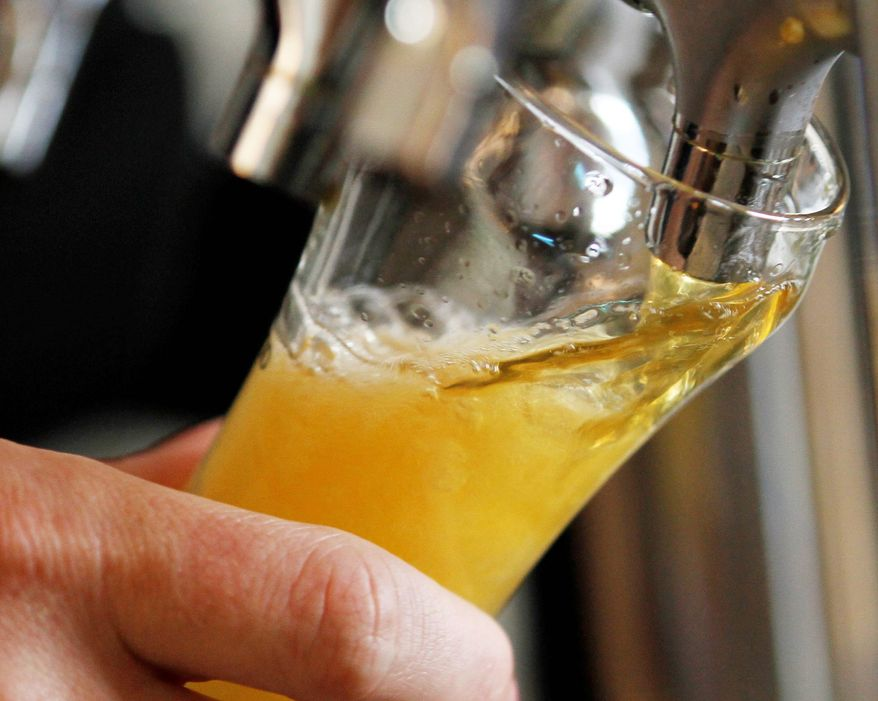 A sample being poured at Hardywood Park Craft Brewery is one of more than a dozen the brewery produces, some available at retail and others only on tap there. (Associated Press)