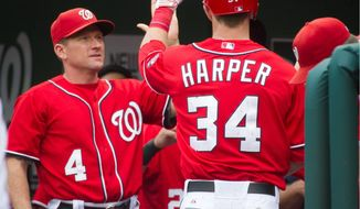 Hitting coach Rick Eckstein, greeting Bryce Harper after a home run Sunday against the New York Mets, has watched the Nationals hit 132 homers in 122 games. They had 112 in the same number of games last season. (Rod Lamkey Jr./The Washington Times)