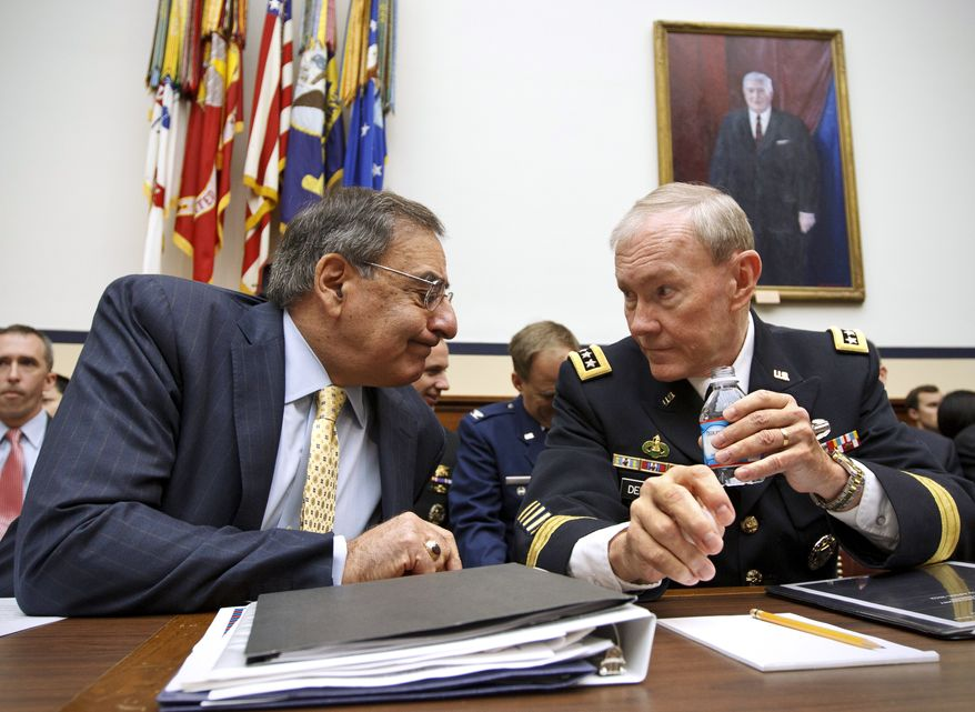 Defense Secretary Leon E. Panetta and U.S. Army Gen. Martin Dempsey, chairman of the Joint Chiefs of Staff, confer on Capitol Hill in Washington before testifying before Congress on Thursday, April 19, 2012. (AP Photo/J. Scott Applewhite)