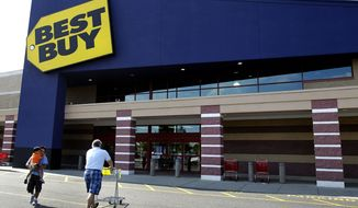 In this Thursday, June 21, 2012, file photo, customers walk in and out of Best Buy in Danvers, Mass. Best Buy Co. is reporting Monday, Aug. 21, 2012, a 90 percent drop in net income during the second quarter, dragged down by restructuring charges and weak sales. The company also withdrew its earnings guidance for the year.(AP Photo/Elise Amendola)