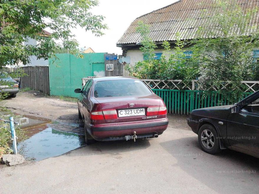 People in Kazakhstan have posted more than 1,500 images of bad parking on city streets on the website oselparking.kz, including SUVs parked snugly in the middle of narrow streets or left on sidewalks, saloons stretched out to block in three parked cars at once, and a stretch limousine jutting out across an entire lane of traffic. One poster claims the car seen here, parked close to a driving school in the northern city of Kokshetau, belongs to a police officer. (oselparking.kz)