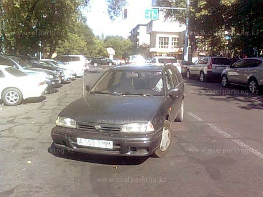 People in Kazakhstan have posted more than 1,500 images of bad parking on city streets on the website oselparking.kz, including SUVs parked snugly in the middle of narrow streets or left on sidewalks, saloons stretched out to block in three parked cars at once, and a stretch limousine jutting out across an entire lane of traffic. (oselparking.kz)