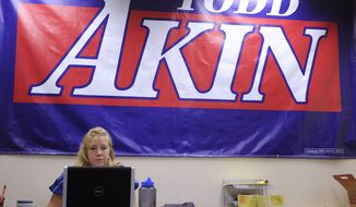 """Alaina Carnan of Lexington, Ky., works Aug. 21, 2012, in the Senate campaign office of Rep. Todd Akin, Missouri Republican, in Chesterfield, Mo. Akin has come under pressure to abandon his Senate campaign after his comments that women's bodies can prevent pregnancies in cases of """"legitimate rape."""" (Associated Press)"""