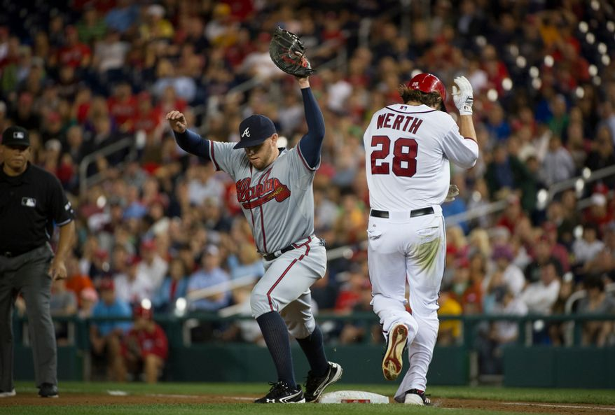 Washington Nationals OF Jayson Werth (28) is called out at first base in the fifth inning of the Nationals' 5-4, 13-inning home victory over the Atlanta Braves on Aug. 20, 2012. (Rod Lamkey Jr./The Washington Times)