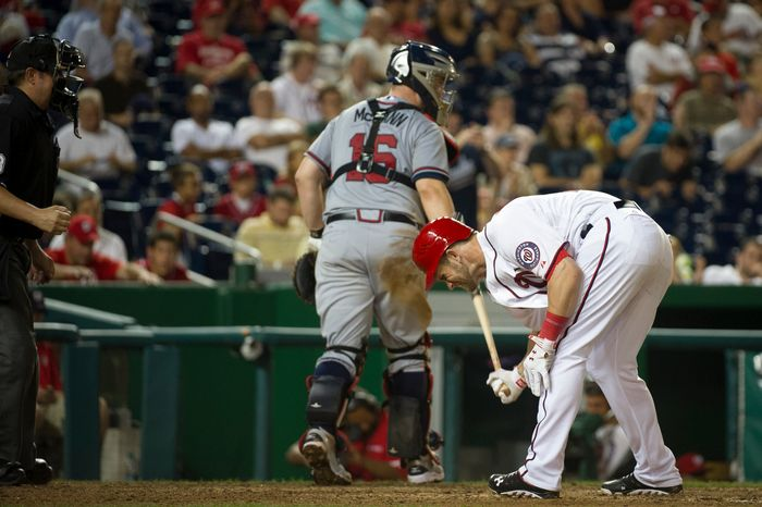 Washington Nationals OF Bryce Harper breaks his bat on the ground after striking out in the 11th inning of the Nationals' 5-4, 13-inning home victory over the Atlanta Braves on Aug. 20, 2012. (Rod Lamkey Jr./The Washington Times)