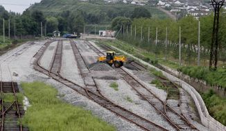 Construction is under way on Monday, Aug. 20, 2012, along railroad lines linking tracks in Rason in far northeastern North Korea with Russian rail lines. (AP Photo/Kim Kwang Hyon)