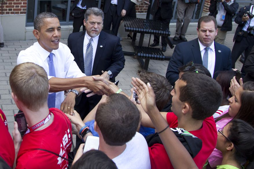 President Obama greets people at the Ohio State University Student Union on Tuesday, Aug. 21, 2012, in Columbus, Ohio. (AP Photo/Carolyn Kaster)