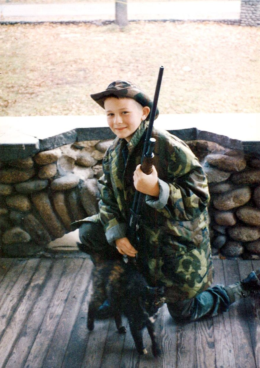 Josh Olson plays army as a child.  (Courtesy of the Olson family)