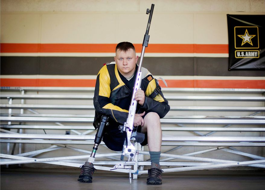 In this Wednesday, May 30, 2012 photo, U.S. Army Sgt. Josh Olson is photographed on the shooting range after practice at Fort Benning, Ga. Olson was on a routine patrol in Tal Afar, Iraq, when a grenade that was lobbed at his Humvee exploded. He lost his right leg in the attack, and would end up spending 18 months at the Walter Reed National Military Medical Center. It was during that time that he took a trip to a shooting range, and impressed officials from the U.S. Army with his marksmanship, becoming the first athlete with a physical disability to be nominated to the Army's World Class Athlete Program. Now, Olson is setting his sights on a gold medal at the Paralympic Games in London. (AP Photo/David Goldman)