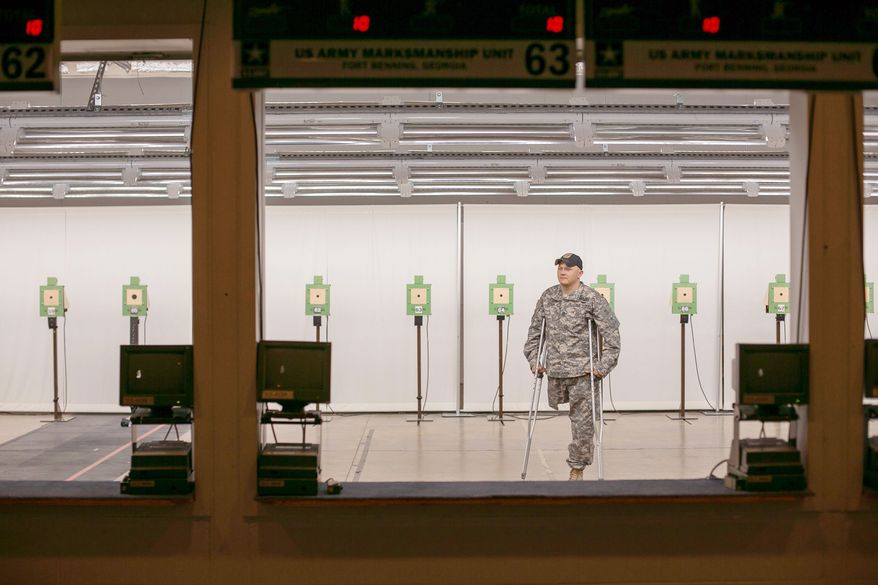 SFC Josh Olson, a U.S. Army Paralympic marksman, stands checks out the indoor rifle range at Wagner Range, in Ft. Benning, Ga., Thursday, May 31, 2012. Olson sustained heavy damage to his leg during an ambush attack in Iraq in 2003, in which his right leg had to be amputated. He's currently a apart of the wounded warrior program and the first active duty soldier to qualify for a Paralympics in the field of mixed 50 meter rifle and mixed 10 meter air rifle. (Andrew S. Geraci/The Washington Times)