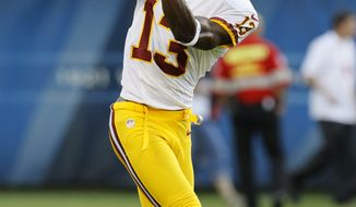 Washington Redskins wide receiver Anthony Armstrong (13) warms up before an NFL preseason football game against the Chicago Bears in Chicago, Saturday, Aug. 18, 2012. (AP Photo/Charles Rex Arbogast)