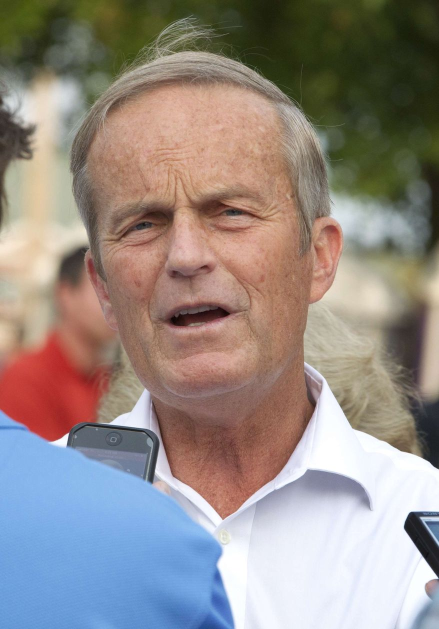 ** FILE ** In this Thursday, Aug. 16, 2012, photograph, Rep. Todd Akin, R-Mo., talks with reporters while attending the Governor's Ham Breakfast at the Missouri State Fair in Sedalia, Mo. (AP Photo/Orlin Wagner)