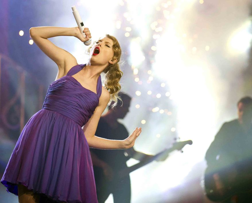 ** FILE ** This Nov. 22, 2011, file photo shows singer Taylor Swift performing at Madison Square Garden in New York. (AP Photo/Charles Sykes, file)