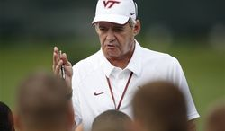 This Tuesday, Aug. 7, 2012 photo, Virginia Tech head coach Frank Beamer addresses his team during football practice in Blacksburg, Va.(AP Photo/The Roanoke Times, Daniel Lin)