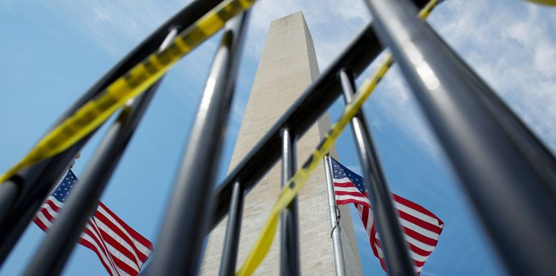 The Washington Monument remains closed behind a barricade with police tape as a result of damage sustained during the earthquake. (Rod Lamkey Jr./The Washington Times)