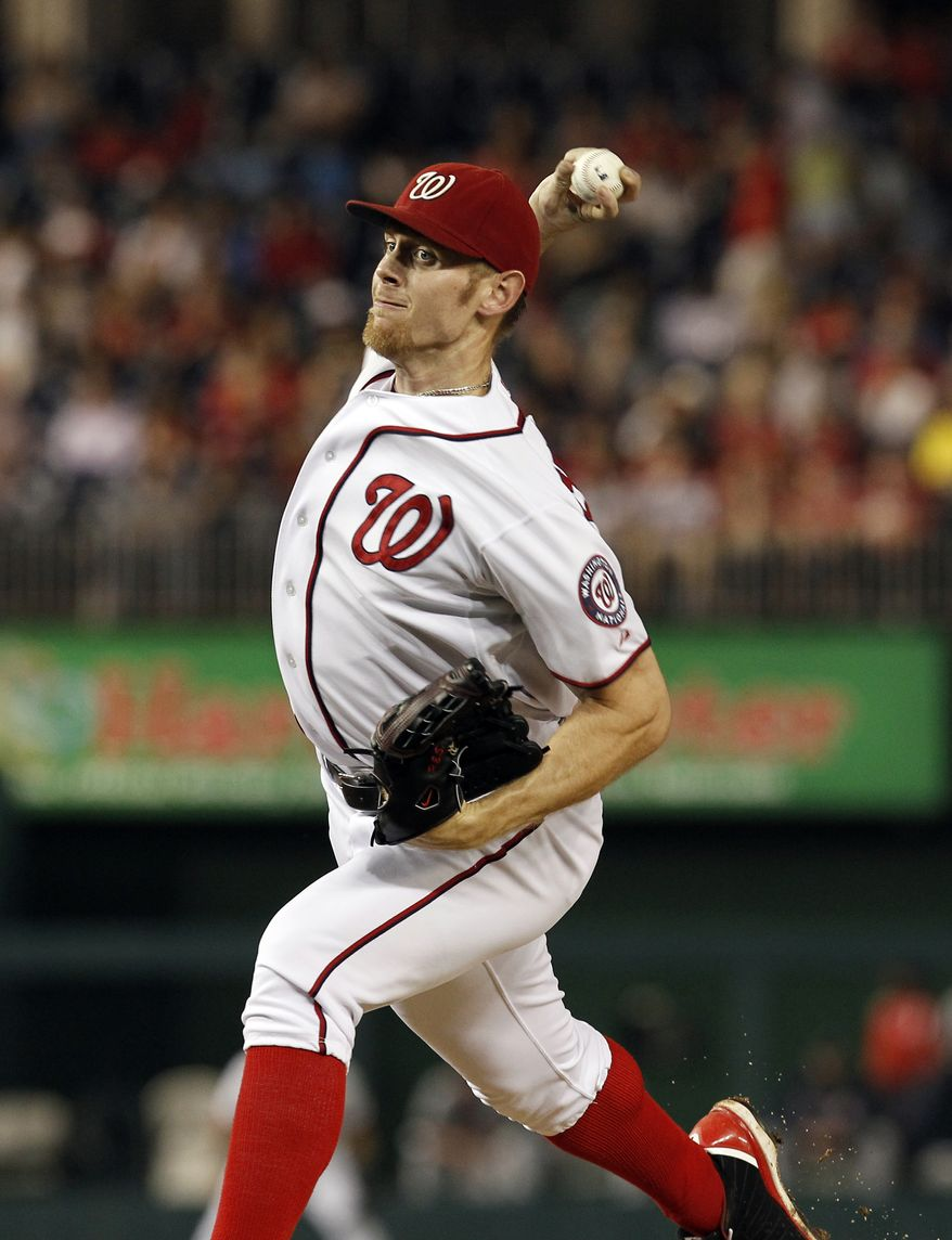 Washington Nationals starting pitcher Stephen Strasburg, throws during a baseball game with the Atlanta Braves at Nationals Park on Tuesday, Aug. 21, 2012, in Washington. The Nationals won 4-1. (AP Photo/Alex Brandon)