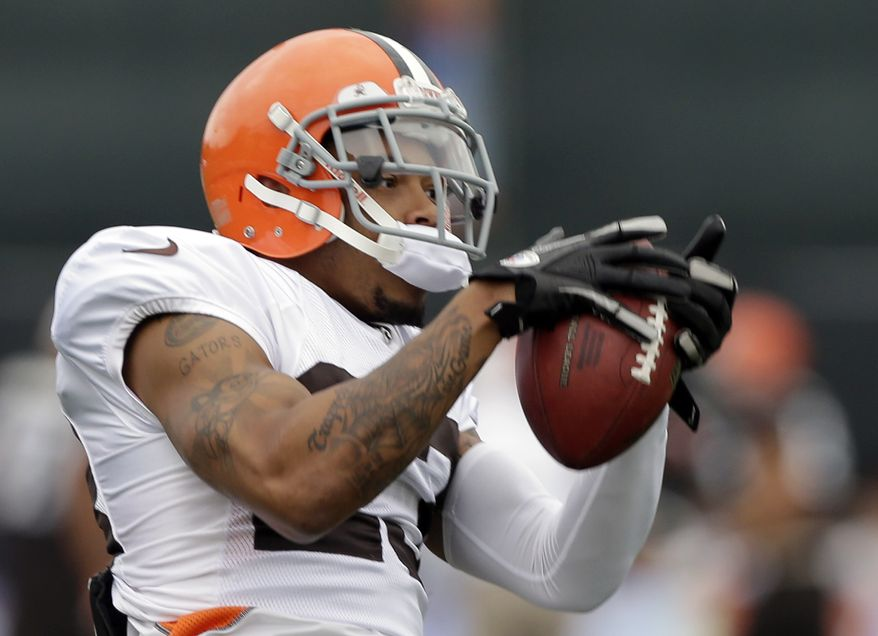 Cleveland Browns defensive back Joe Haden catches a pass during training camp at the NFL football team's practice facility in Berea, Ohio Tuesday, Aug. 21, 2012. (AP Photo/Mark Duncan)