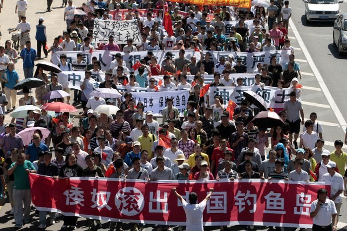In this Sunday Aug. 19, 2012 photo, anti-Japan protesters march in Harbin, in northeastern China's Heilongjiang province. An unauthorized landing by Japanese activists on a tiny island in what the Japanese call the Senkaku chain - and the Chinese call the Diaoyu - sparked an outpouring of anger and anti-Japanese protests across China and fueled calls for aggressive government action that some fear