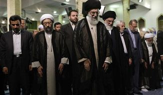 ** FILE ** In this photo released by the official website of the Iranian supreme leader's office and taken on Tuesday, July 24, 2012, Iranian supreme leader Ayatollah Ali Khamenei, center, leads prayer, in Tehran, Iran. (AP Photo/Office of the Supreme Leader)
