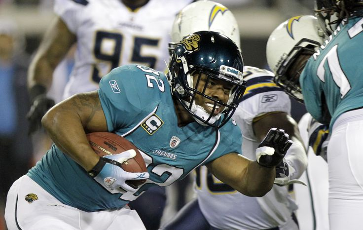 FILE - This Dec. 5, 2011 file photo shows Jacksonville Jaguars running back Maurice Jones-Drew running against the San Diego Chargers during the first half of an NFL football game, in Jacksonville, Fla. Jones-Drew's holdout appears far from over.  His agent, Adisa Bakari, told The Associated Press on Tuesday, Aug. 21, 2012, that the Jaguars running back is upset with owner Shad Khan's recent public comments about his client's 27-day holdout.  (AP Photo/John Raoux, File)