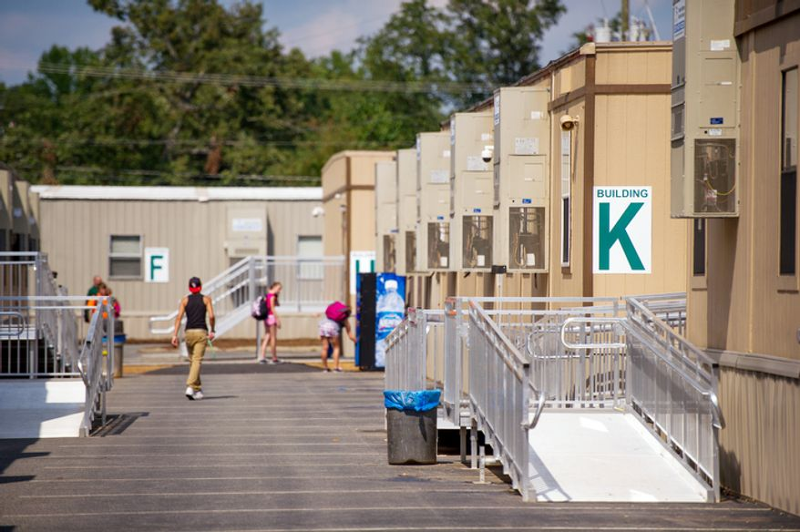 Louisa County High School students walk to dozens of trailers used to learn since their school building sustained massive structural damage and was deemed unsafe as a result of the magnitude 5.8 earthquake that hit in August of last year. (Andrew Harnik/The Washington Times)