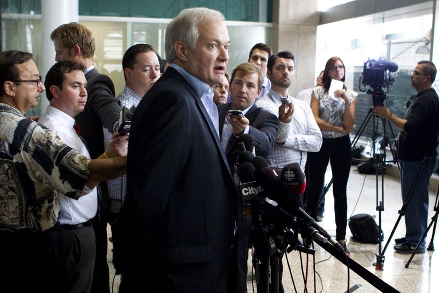 Donald Fehr, center, executive director of the NHL Players' Association, speaks to journalists following labor talks with the NHL, Wednesday, Aug. 15, 2012, in Toronto. (AP Photo/The Canadian Press, Chris Young)