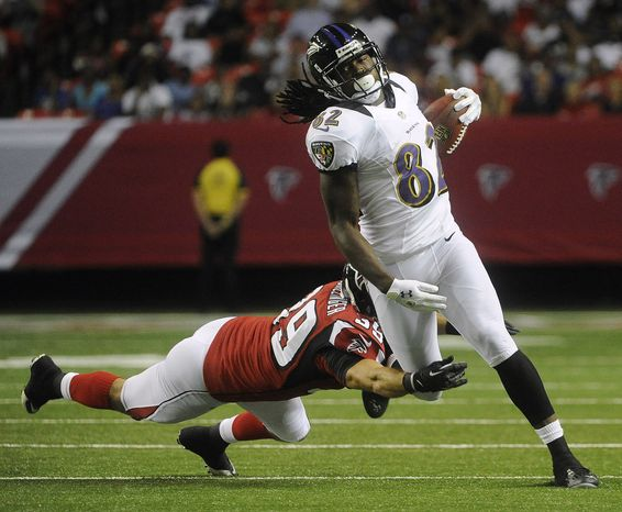 Baltimore Ravens wide receiver Torrey Smith (82) runs against Atlanta Falcons defensive back Shann Schillinger (39) during the first half of an NFL preseason football game, Thursday, Aug. 9, 2012, in Atlanta. (AP Photo/John Amis)