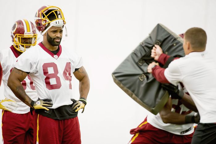 Washington Redskins tight end Niles Paul (84), second from left, stands in line to run a drill in the team's indoor training facility during mini camp at Redskins Park, Ashburn, Va., Tuesday, June 12, 2012. (Andrew Harnik/The Washington Times)