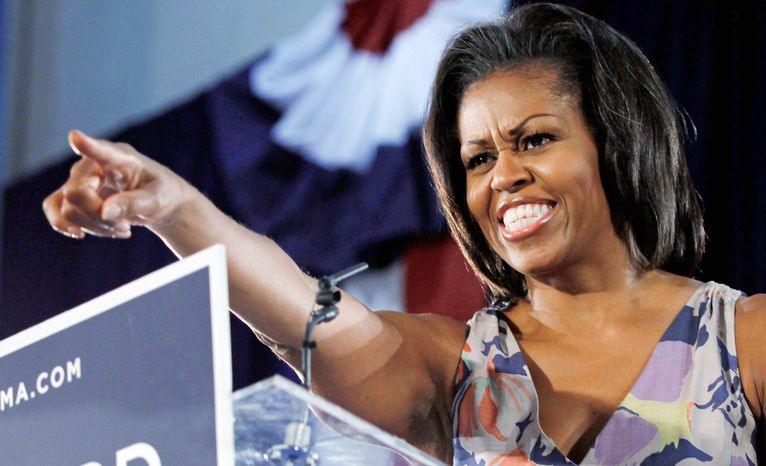 First lady Michelle Obama points to supporters at the War Memorial Auditorium in Fort Lauderdale, Fla., on Wednesday, Aug. 22, 2012. (Associated Press)