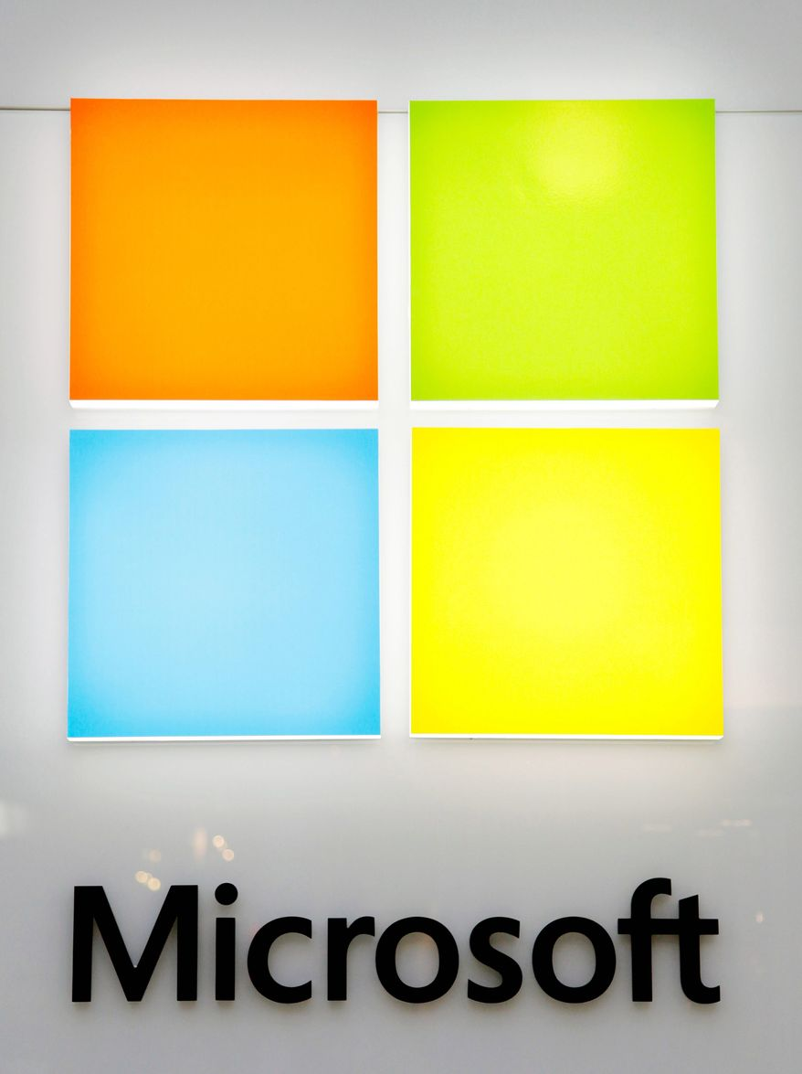 The Microsoft logo redesign features the name in a lighter, straight font and the familiar red, blue, yellow and green colors. (Associated Press)