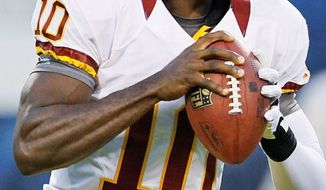 Redskins rookie quarterback Robert Griffin III (left) won the Heisman Trophy last year, and Colts counterpart Andrew Luck finished second. Their fortunes were reversed on draft day in April when Indianapolis selected Luck with the No. 1 overall pick, and Washington traded up with St. Louis to take Griffin at No. 2. The two will square off Saturday in an exhibition at FedEx Field. (Associated Press)