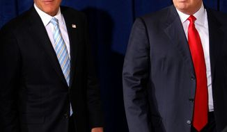 Mitt Romney (left) and Donald Trump stump in Las Vegas in August. (Associated Press)