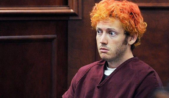 ** FILE ** Prosecutors say James Holmes, seen here in court July 23, 2012, was banned from the University of Colorado. (Associated Press)