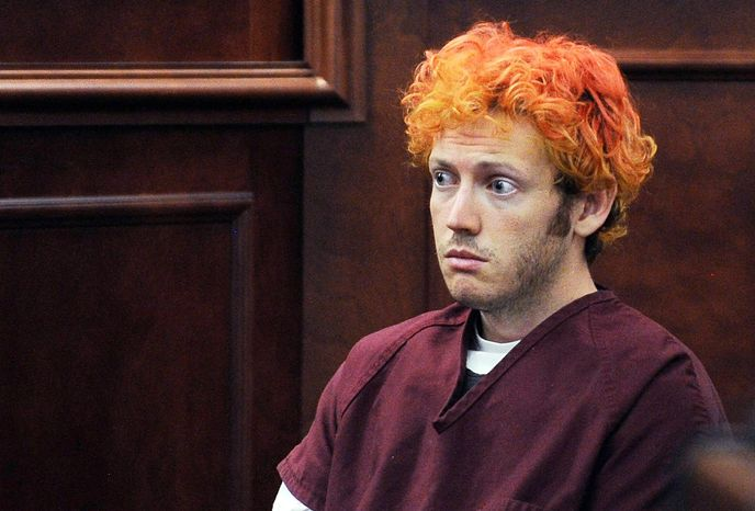 ** FILE ** Prosecutors say James Holmes, seen here in court July 23, 2012, was ba
