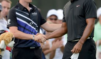 Tiger Woods, right, shakes hands with Rory McIlroy of Northern Ireland before the start of The Barclays golf tournament at Bethpage State Park in Farmingdale, N.Y., Thursday, Aug. 23, 2012. (AP Photos/Henny Ray Abrams)