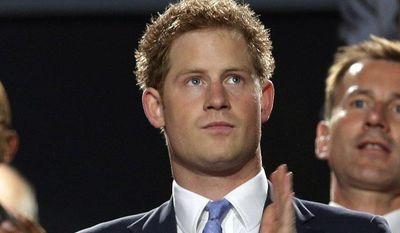 Britain's Prince Harry applauds during the closing ceremony of the 2012 Summer Olympics on Sunday, Aug. 12, 2012, in London. (AP Photo/Charlie Riedel)
