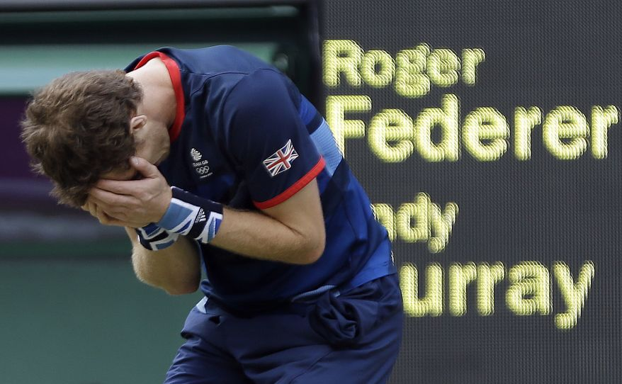 Andy Murray of Great Britain reacts after defeating Roger Federer of Switzerland in the gold medal men's singles match at the All England Lawn Tennis Club in Wimbledon, London at the 2012 Summer Olympics, Sunday, Aug. 5, 2012. (AP Photo/Elise Amendola)