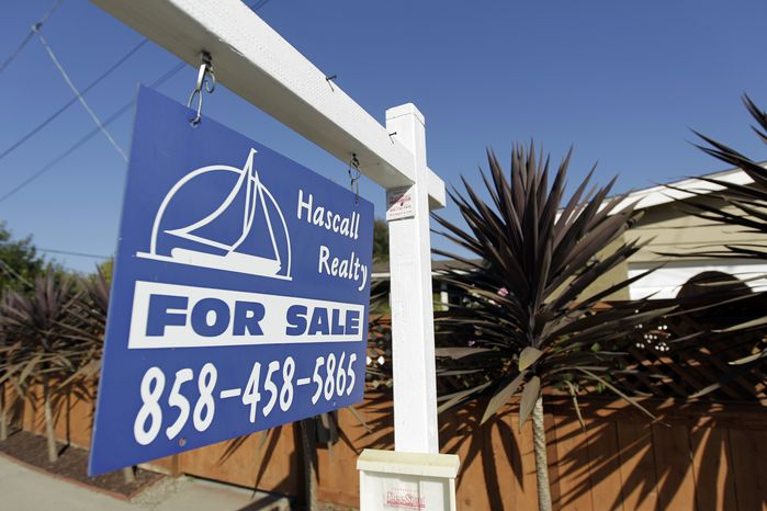 ** FILE ** A real estate agency sign advertises a house for sale in San Diego on Wednesday, June 13, 2012. (AP Photo/Gregory Bull)
