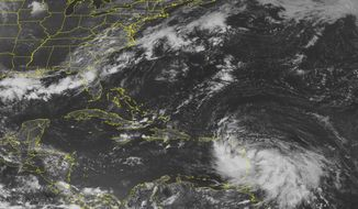 Tropical Storm Isaac, in the lower right corner, moves over the Lesser Antilles in a satellite image from the National Oceanic and Atmospheric Administration taken on Wednesday, Aug. 22, 2012, at 1:45 p.m. EDT. (AP Photo/Weather Underground)